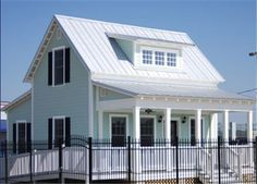"""Lowe's Makes """"Katrina Cottages"""" Available Nationwide - you can buy plans or a house kit with building matirials"""