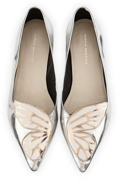 Sophia Webster metallic leather flat with butterfly wing appliqu. 0.5 flat heel. Pointed toe. Tonal topstitching. Leather outsole. Slip-on style. Bibi Butterfly is made in Brazil.