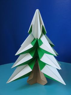 Abete - Fir tree. Origami, no cuts, no glue, 5 squares of paper. Designed and folded by Francesco Guarnieri, October 2007. Diagrams in CDO Convention Book, December 2008.
