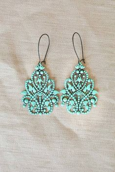 Shop for beautiful and bright teal chandelier-style earrings perfect for summer online at Shabby Apple! Find vintage & retro-style modest clothing & accessories for women in a variety of colors, fabrics & types at www.shabbyapple.com.