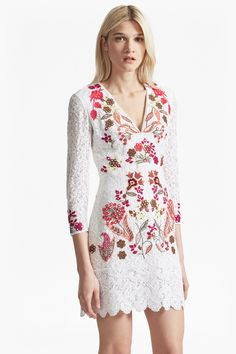 <ul> <li> Non-stretch floral cotton-lace dress with multicoloured embroidery and embellishment</li> <li> Deep V-neck with white embroidered trim</li> <li> Long sleeves in sheer lace</li> <li> Concealed back zip fastening and hook closure</li> <li> Lined at body</li> <li> Fitted style</li> <li> UK size 10 length is 85cm</li> </ul>  <strong>Our lead model...