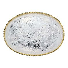 """Montana Silversmiths Belt Buckles - Both understated and strikingly beautiful, there is a reason our authentic fully engraved western style silver belt buckles remain best sellers throughout the years. This small, oval shape belt buckle features bright cut filigree swirls with four flower accents, all neatly framed with silver stippling. Brightly polished gold twisted rope trim. Standard 1.5"""" belt swivel. $50.00"""