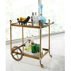 Cheval Bar Cart. Antiqued brass with mirrored shelves, nickel and lucite accents, and our signature horse finials.