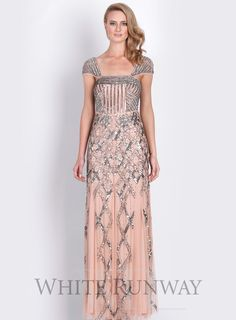 Loretta Beaded Gown by Montique. A stunning full length gown by designer Montique. A sequin mesh dress in a soft dusty pink with allover patterned sequin embellishment and cap sleeves. Perfect for mother of the brides.