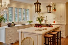 gorgeous metal decorative drawer pulls, white cabinets, built in pantry wall, no upper cabinets, great view!