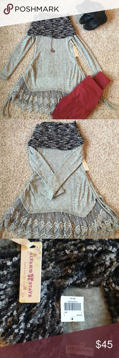 "NWT Altar'd State Gray Sweater This sweater has lots of little details that make is versatile and fun! It is about 33"" long to the tip of the lace part so I would wear it as a shirt, but others may prefer it as a dress. The cowl neck is soft with gray, black, and white specks while the bottom has lacelike detailing that adds a Boho look. The sides can also be tightened and tied up so that the sides are shorter than the front and back. Fantastic for fall ☺️🍂🍁 Altar'd State Sweaters Cowl…"