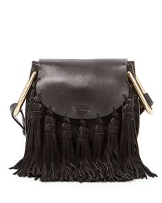 Chloe calfskin and napa lambskin shoulder bag with suede tassel trim. Wide shoulder strap with large U-shaped rings. Woven trim along frame of body. Flap top with logo embossing. Hidden magnetic closu