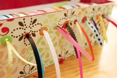 Ribbons in a shoebox! Great way to organize ribbons and recycle a shoe box.
