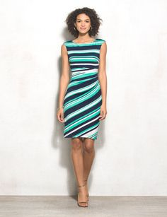 Colorful stripes will score you major style points this season. And with a comfy knit fabric with figure-flattering details, what's not to love? We'll be rocking this dress to the office with a white or navy blazer over top! Imported.