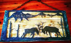 Elk fighting metal welcome sign with wood insert I have for sale.