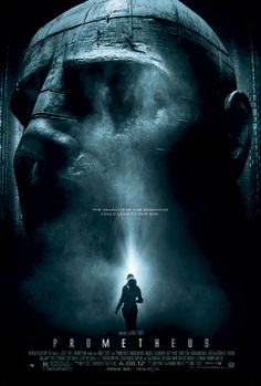"""A female figure in silhouette stands before an enormous statue of a humanoid head. Text at the middle of the poster reveals the tagline """"The..."""