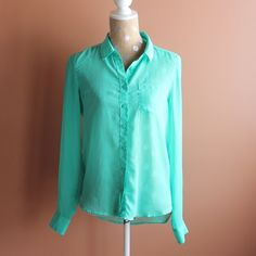 American eagle chiffon teal blouse A wonderful chiffon teal blue green American eagle button up blouse. The blouse is sheer and will need an tank to be worn underneath. Hi low blouse so great to wear with leggings if you so choose or can be tucked in for a more office appropriate look. *pet free smoke free home *bundle discounts *usually ships next day *no swaps/reserves American Eagle Outfitters Tops Button Down Shirts