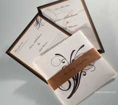 You can add flare to your wedding invitation by adding a personalized belly band.