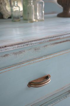 Stunning blue distressed painted drawers.