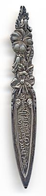 """This bookmark is manufactured by the Alvin Corp. It has one of the Alvin hallmarks and is also marked Sterling on the back. The front inscription reads """"And there's pansies, thats for thoughts."""" This is a quote from Hamlet (Act IV, Scene V).  To see the catalog page, click here. Date:1901 - 1910 Manufacturer:Alvin Corp. Materials:Silver Origin:US Shape:Flower Shape:Shakespeare Size: 1/2 X 3 3/4 in"""