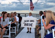 The cutest way to announce the bride's grand entrance. SOLARIS yacht wedding Destin Florida.