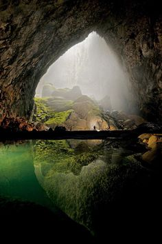 This is a cave in Vietnam; the lake is bottomless.  The photographer is Carsten Peter.