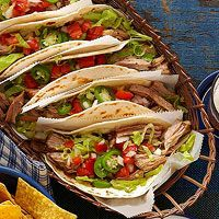 Slow Cooker Shredded Pork Tacos Recipe..Root beer and chipotle chiles may seem like strange selections for your pork taco sauce, but they actually create a perfect balance of sweet and spicy. Trust us, these tempting tacos are well worth the try!