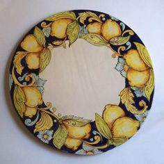 <p>This handmade tile panel, ideal as a ceramic side table top, depicts a classic Mediterranean design, with ripe lemons and flowers.<br />Ghenos is a Sicilian pottery studio in Messina, run by the Scardino brothers, Vincenzo and Enzo. They specialize in archaic, Baroque and istoriato designs from the Sicilian art heritage. Each piece is the result of a thorough historical and stylistic research and painstaking craftsmanship. The quality of their architectural pottery, often set in handmade…