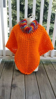 Hot Off My Hook! Project: Cowl Neck Poncho Started: 10 Mar  2016 Completed: 13 Mar 2016 Model: Madge the Mannequin Crochet Hook(s): 7mm, Cowl portion, K, Granny Stitch portion Yarn: RedHeart Super Value Color(s): Sunrise, Carrot Pattern Source: Simply Crochet Magazine, Issue No. 25 (Hard Copy) Pattern Designed By: Simone Francis Notes: This is my 79th Cowl-Neck Poncho!