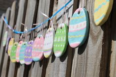 Salt dough Easter egg garland -- We loved salt dough at Christmas!  How sweet would it be to make salt dough crosses to paint?!