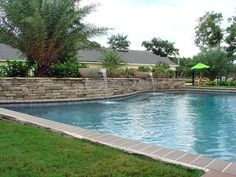 Backyards are suppose to be relaxing and a place to have fun. That's exactly what this backyard in Jacksonville, FL promotes. 5 Star Outdoor Design custom built this pool with the beautiful water bowl features. They also built the outdoor paver areas in such a way that there are multiple spots to choose from when you want to kick back and relax.