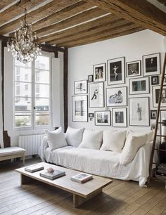 Chic living room with exposed beams, a large gallery wall, a white sofa, and a vintage chandelier Want to elevate the look of your small apartment? These modern apartment décor ideas will make your space feel bigger and more expensive. Chic Living Room, Home And Living, Living Room Decor, Modern Living, Barn Living, Kitchen Living, Country Living, Paris Apartments, Cool Apartments
