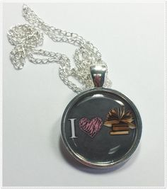 Perfect gift for the teacher, librarian, author, or just all-around book-lover in your life.  * Pendant measures aprox (1 inch) across and comes on a 20 inch cable chain with a lobster clasp closure.  * Or a pendant on a keyring  *please choose upon checking out.