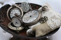 Pretty old pocket watches in a bowl...New Years idea.