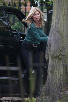 Weekend style: Kate Moss sported a country-inspired ensemble featuring flat boots and blac...