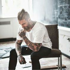 Hair, beard, tattoos.