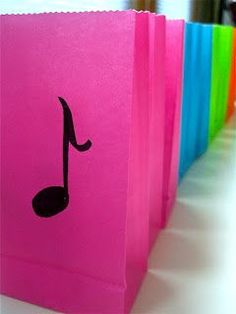 For a music theme birthday party. A simple note drawn on to colorful gift bags. Notes and treble clefs, etc made out of chocolate that i could decorate her cake with