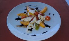 It is summer. That means ripe juicy peaches. Summer Peaches, Cherry Tomatoes, Burrata, with a Balsamic glaze.  Gluten Free. Full recipe @  LRModernAlchemy.com