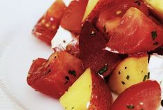 This salad is perfect for the summer, when both peaches and tomatoes are in season.