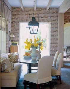 Stolen from my sister. Kitchen eating area with a bench, brick and a big lantern! Maybe not white fabric + little kids... certainly could do it w/wood, and I LOVE the brick inside! And the ceiling!