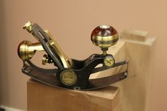 Righthand view of handmade Compass Plane in brass by Abiel Rios Wong
