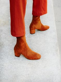 North Shore Heel Boot   This chic mid-rise suede boot is a wardrobe essential and will literally go with everything! Features a squared toe and block heel with an exposed zip closure in back for an easy on-off. The faux-suede upper has a slight stretch for an easy and effortless fit.