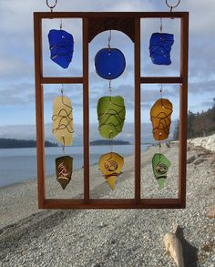 Suncatcher. Framed glass. Sea glass beach glass by CoastChimes  (What if I used driftwood and rocks from our river?)