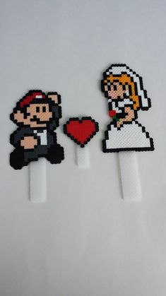 Cake Topper- Mario and Princess Peach Wedding Cake Topper – Video Game Wedding – 8 Bit Wedding Cake Topper – Nerdy Wedding Product details: These are handmade Mario and Princess Peach cake toppers! They are made of plastic fuse beads. Perler Bead Mario, Diy Perler Beads, Pearler Beads, Video Game Wedding, Wedding Games, Wedding Ideas, Hama Beads Patterns, Beading Patterns, Mario And Princess Peach