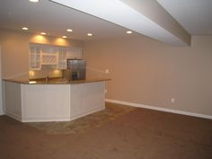 white cabinets in basement | Simple White Basement Renovation Idea with Brown Floor, White Wall ...