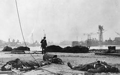 """historywars: """" A German soldier inspects the battlefield with dead English soldiers lying on the ground at the bay of the port city St. Nazaire, France, on April after the battle with German. Dieppe Raid, British Commandos, St Nazaire, North African Campaign, Germany Ww2, History Online, Japanese American, British Soldier, German Army"""