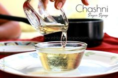 Chashni meaning in english is Sugar Syrup. Make one string thick Chashni with tried and tested recipe video and pictures for Indian recipe like Gulab Jamun. Gulab Jamun, White Wine, Syrup, Indian Food Recipes, Food Videos, Alcoholic Drinks, Sugar, Glass, Desserts