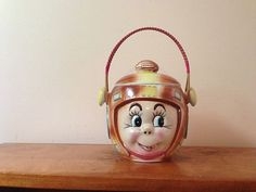 Mouse over image to zoom     VINTAGE FOOTBALL HELMET COOKIE OR CANDY JAR