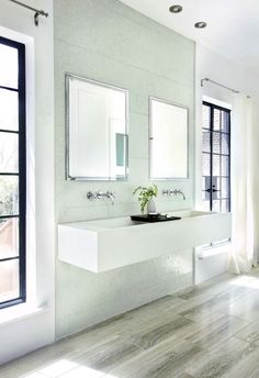 Beautiful contemporary bathroom. Travertine wood-grain tile, mosaic wall, floating trough sink, wall mount faucets