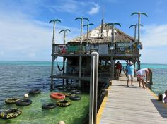 Palapas Bar and Grill; best conch on the island, plus if you don't want to get out of the water they'll rope you down an ice cold bottle of beer in a bucket. Ambergris Caye, Belize Travel, Getting Out, Aqua Blue, Trip Planning, First Time, Gazebo, Places To Go, Outdoor Structures