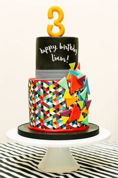 birthday cake bold geometric modern fun triangles primary colours boy girl 3rd birthday party kids 2 tiers Sweet Sugar Sixpence Clare Robinson Photography