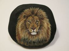 Lion-portrait-hand-painted-on-a-rock-by-Ann-Kelly