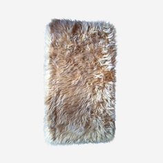 Handmade shag wool rug. The entire rug is wool, including the backing from which the tapered shag emerges. They continue to be handmade in the mountains of Greece and are regarded as desirable in American modern decor and children's rooms. The flokarti rug is a classic retro edition to any home.