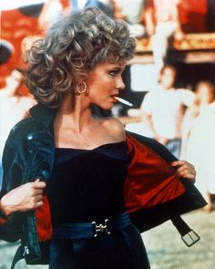 Olivia Newton John as Sandy Olson