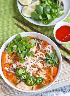 Asian-Inspired Slow Cooker Chicken Noodle Soup Recipe || Plenty of hearty chicken and vegetables, garnished with fresh herbs, lime and jalapeno slices.